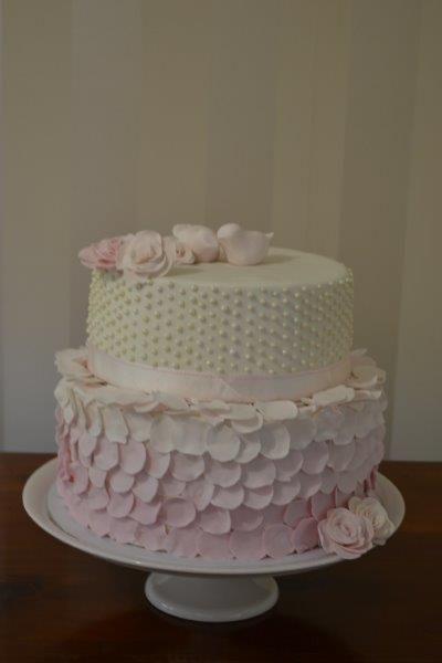 A beautiful cake to celebrate a beautiful engagement. Moist chocolate layers with a chocolate hazelnut buttercream, decorated with doves, roses, pearls and rose petals