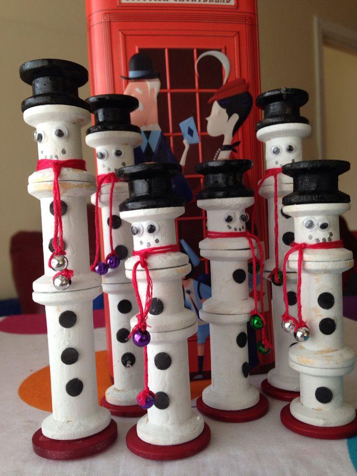 Snowmen from wooden spools.
