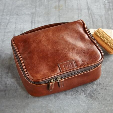 "HOMEWARD BOUND TRAVEL CASE - Make life on the road a bit more comfortable with this thick, pebbled leather travel case. Imported. Approx. 9""W x 8""D x 3-1/2""H."