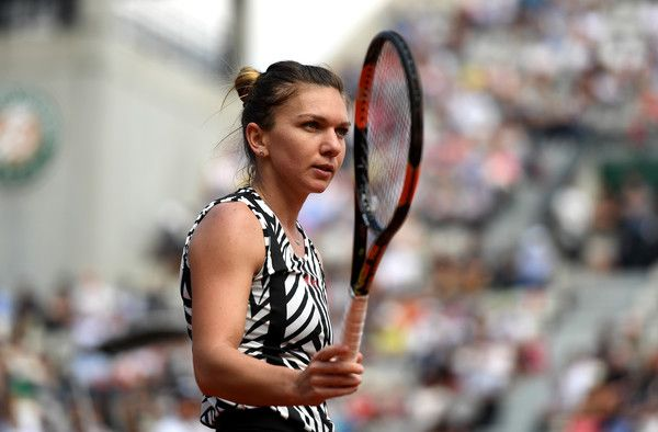 Simona Halep Photos - Simona Halep of Romania reacts during the Ladies Singles third round match against Naomi Osaka of Japan on day six of the 2016 French Open at Roland Garros on May 27, 2016 in Paris, France. - 2016 French Open - Day Six