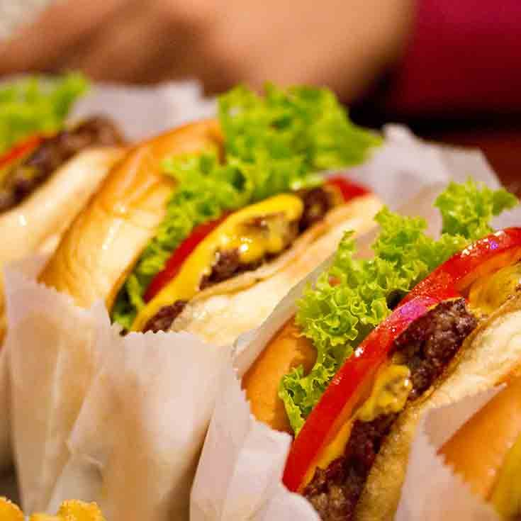 Shake Shack is giving away free burgers to its first 100 customers to celebrate the company's 100th location opening in Boston's Seaport District.