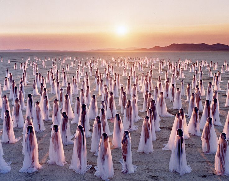 "Desert Spirits in Nevada, shooting from before sunrise ""up until the rays shone through the diaphanous fabric""."