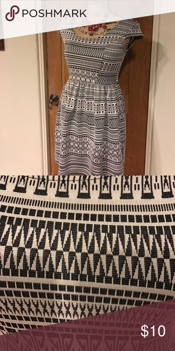 Stretchy little A line dress Stretchy A line short dress . Fun black/cream pattern that pairs well with nearly any color accessory or sweater. Cap sleeves. Rewind Dresses Mini