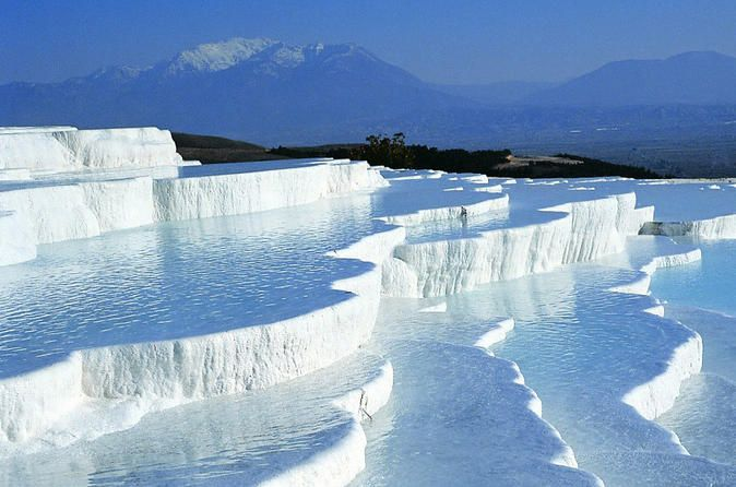 Full-Day Pamukkale Hot springs and Hierapolis Ancient City from Side Visit miracle of the world – cotton castle of Pamukkale -whiteterraces, down of which the thermal water is flooding. Bathe in a thermal antique Cleopatra's pool and visit ancient Roman city – Hierapolis with theatre, temples and huge necropolis. All day trip with 2 meals included in the price.After picking you up from the hotel at early morning hours we will head to the city of Denizli along the Taurus mou...