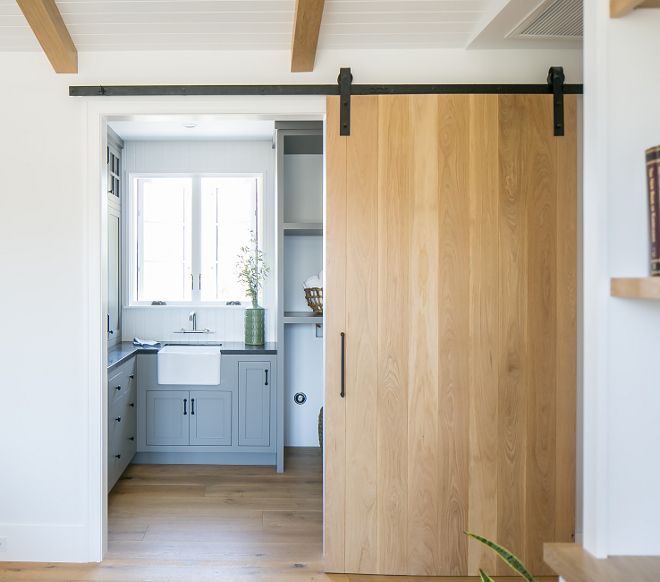 Farmhouse Laundry Room With White Oak Barn Door Details On Home Bunch Laundry Room Remodel Small Guest Rooms
