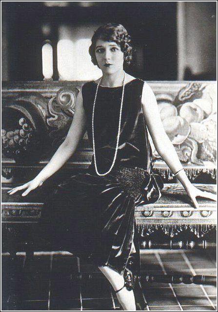 1920s - women's hair was shorter, lips were darker