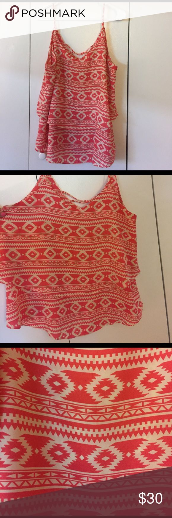 Coral azteca print tank top Large Francesca's coral Aztec print tank top. Flowly with two staggered layers. Cris-crop back. Only worn twice Francesca's Collections Tops Tank Tops