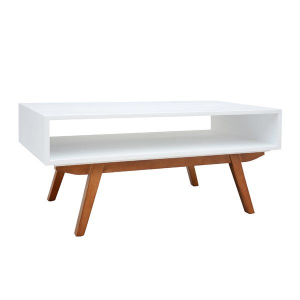 Set your living room or entertainment center apart with the Mid-Century Coffee Table. Contemporary construction and vintage-inspired design come together to shape this unforgettable solid pine coffee table. The clean, open shelf allows you to create a simple, inviting aesthetic and display your favorite books, magazines, or personal curio. The elegantly angled legs are reminiscent of the enduring style and quality craftsmanship of Mid-Century design. Constructed using sustainably sourced…