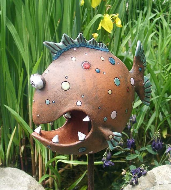 Need a bit of yard art? This snarky little guy might fill the bill.