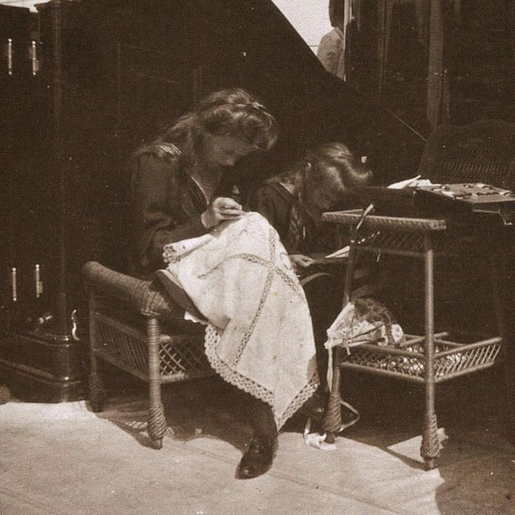 Olga and Anastasia doing embroidery on board the imperial yacht Standart.