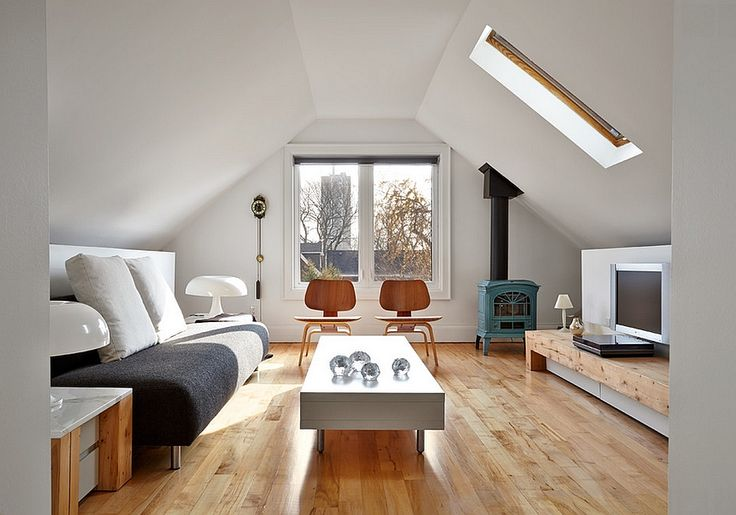 Scandinavian minimalism at its beautiful best in the transformed attic 10 Attic Spaces That Offer an Additional Living Room