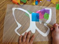 bugs & insects unit -- tissue butterflies on wax paper for window