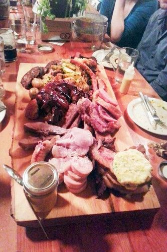 The Monster, a gigantic wood plank arrives with a mountain of pork in just about all its forms: smoked meat, ham, homemade bacon, pig's foot, marinated tongue, garlic sausage, pork chops, pork liver patties, foie gras and apple stuffed sausage, mortadella, pork shoulder and pepperettes.