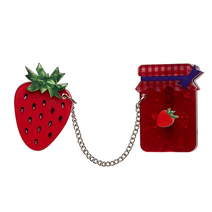 From boutique Australian designer Erstwilder comes this adorable lapel pin! The Fragaria Fruit Fill Brooch is a retro-inspired statement piece featuring an delicious jar of strawberry jelly connected to a plump, sparkling strawberry by a silver chain. Crafted from shades of red, green, and blue resin, this brooch makes a stand-out addition to your favorite picnic outfit!