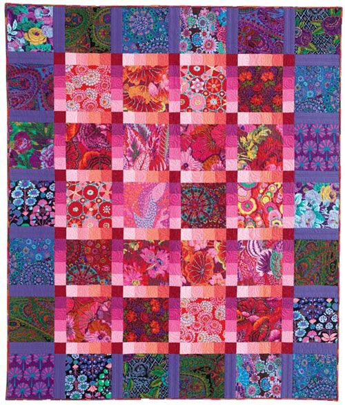 The color play and use of light and dark fabric gives this quilt depth. The dark fabric for the boarder pushes the pink forward.  To see what I mean, hit the pin button and look at the smaller image,  distance shows the effect.
