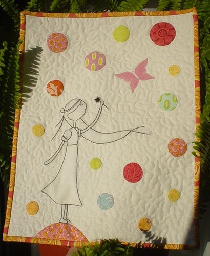 This quilt makes me want to ... quilt!  I love it!