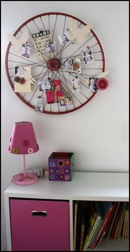 Old bike wheel turned memo board. Great idea for one of the
