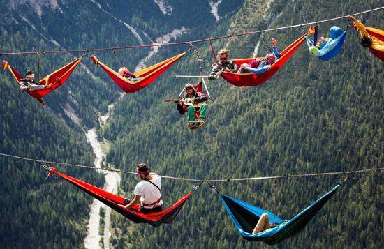 Highliners take a hammock break in the Alps