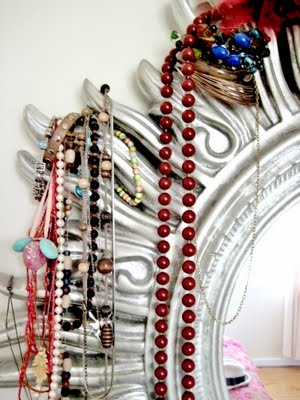 Ahh to use a sun mirror to hang jewelry - brilliant! #decor #home