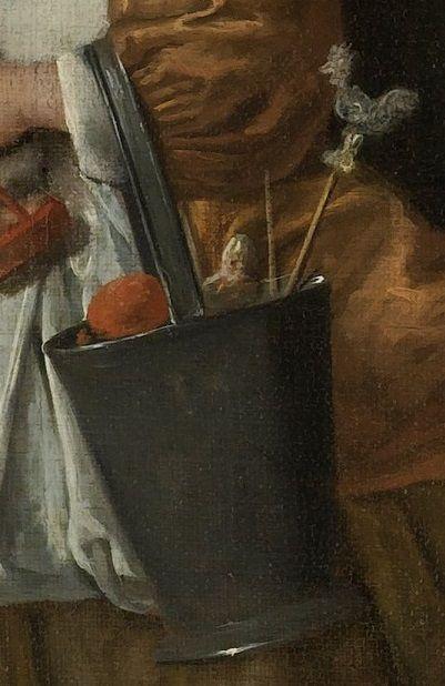 De emmer ...Het kleinste meisje op de voorgrond is wel erg verwend door de Sint. In haar glanzend gepoetste emmertje, dat in die tijd vaak als boodschappentas werd gebruikt, heeft ze haar kleinere geschenken verzameld.