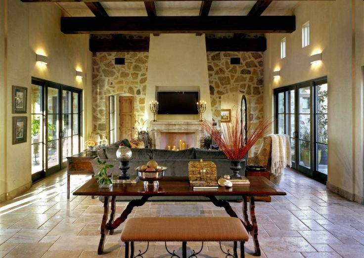 Created Light Every Space Becomes More Elegant with Sconce Lighting Designs: Exposed Wood Beams In Great Mediterranean Living Room Ideas With Sliding Glass Doors And Sconce Lighting Also Ottoman Bench With Sectional Sofa And Stacked Stone Wall Plus Tv Over Fireplace ~ franklester.com Interior Design Inspiration