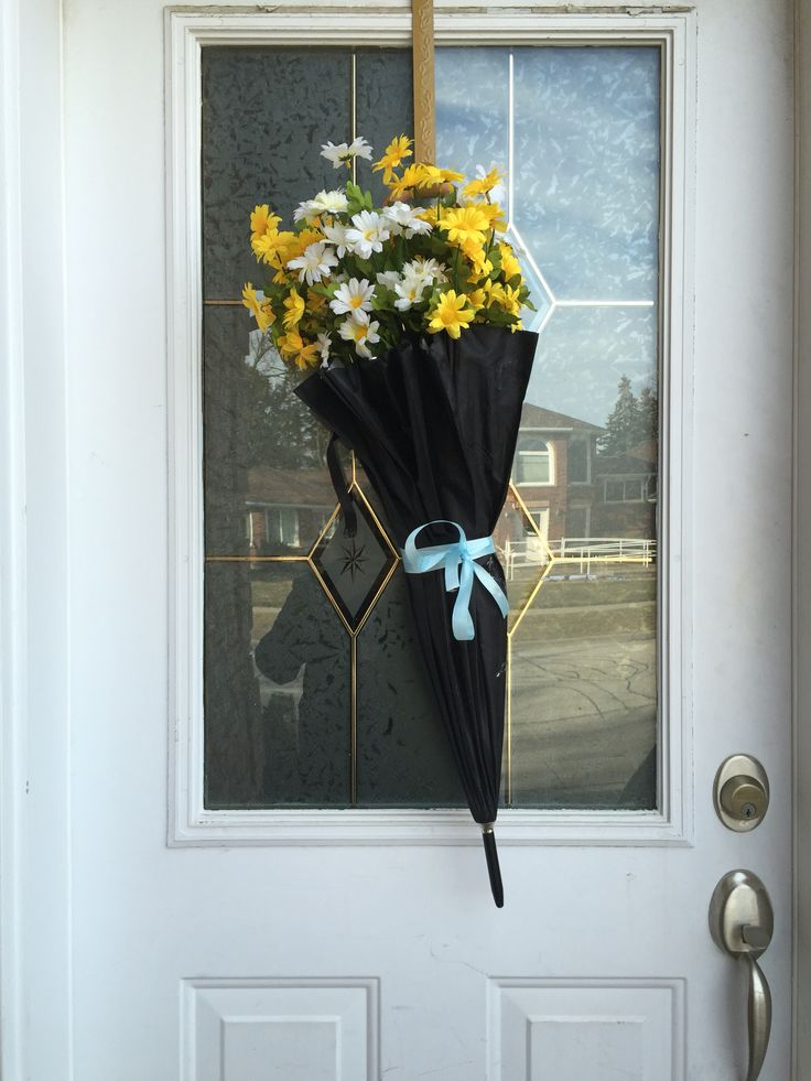 DIY spring wreath. All you need is an umbrella, plastic flowers and ribbon.