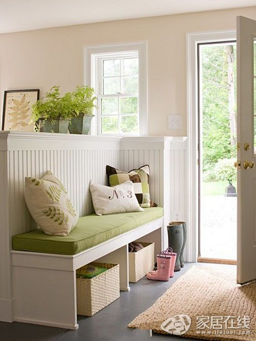 A half- wall to separate the entrance from the living room, but still keeps the open feel of the area