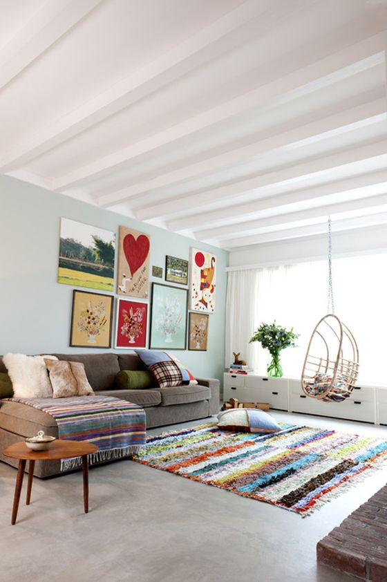 So colorful! I love the woven blanket on the sofa.