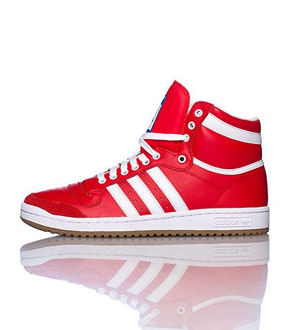 adidas Mid top basketball sneaker Lace up closure Triple adidas stripes detail Perforated toe box Cushioned inner sole for comfort