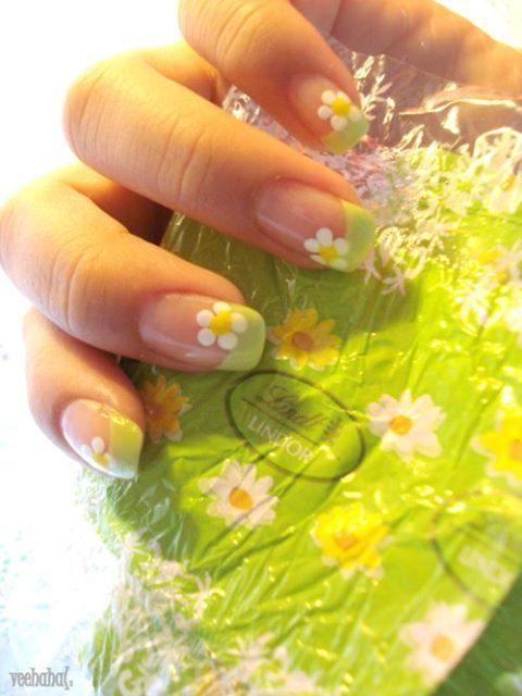 green french manicure design with one little daisy on every corner of every nail:)