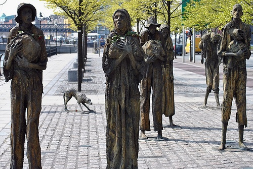 """Famine Statues, Dublin, Ireland These are so haunting to see in person, they are walking toward a ship which is an exact replica of the ones that took the ones escaping the famine to America & other countries, because of the number of people packed into the ships they were labeled """"coffin ships"""" ."""