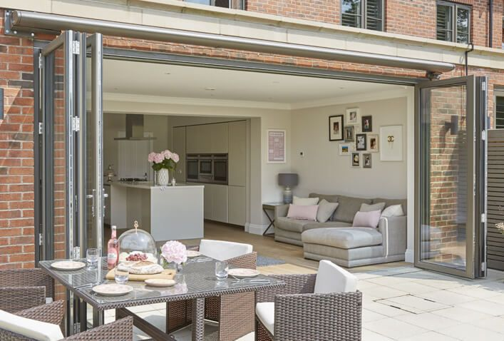 You can create a seamless design with your interiors and exteriors by keeping the floor height the same and allowing the flooring to flow between the two areas. A great set of bifold doors also helps!