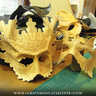 A selection of handmade Green Man masks nearing completion. Each is a one of a kind leather sculpture.