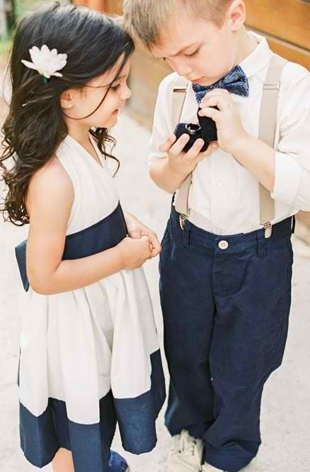 Ring bearer showing off the wedding ring, cute matching outfits!