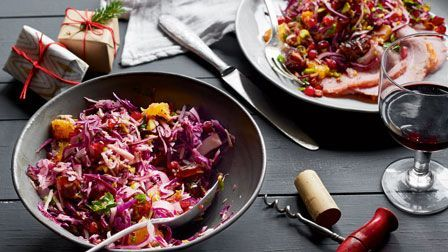 Rich Harris shows you how to make this simple slaw, livened up with seasonal fruit and nut. It's great with gammon, cold cuts and other festive buffet favourites.