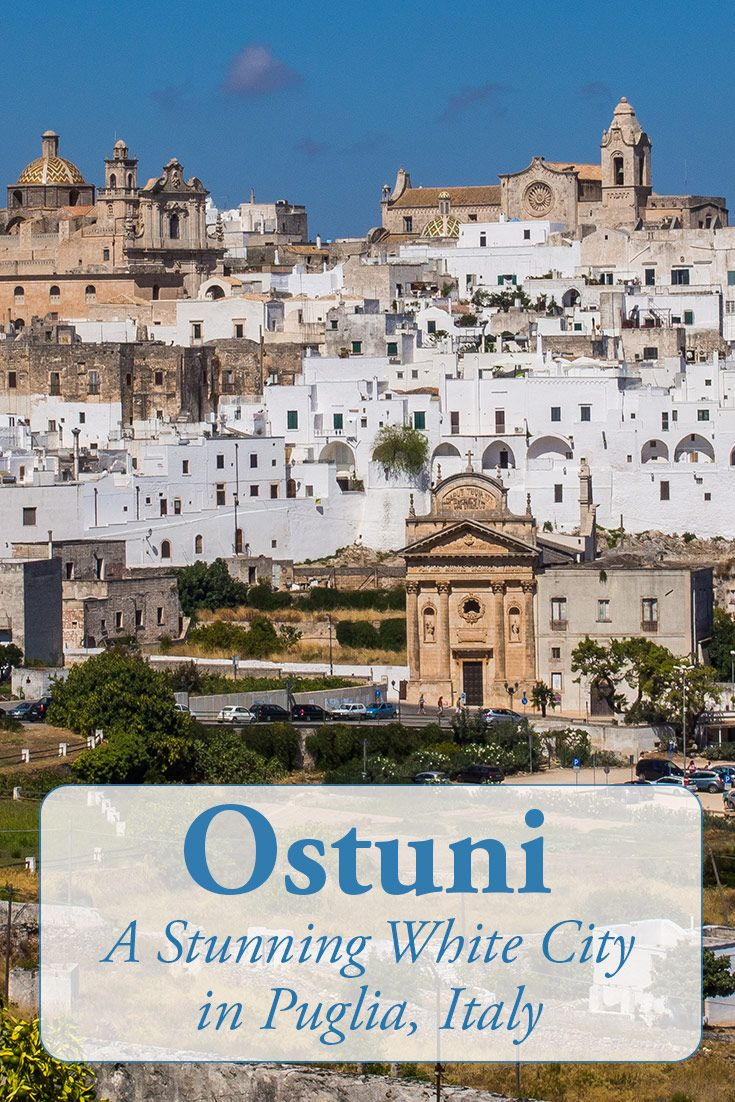 Ostuni, Puglia is one of the most beautiful towns in Italy with a maze of whitewashed buildings perched on a hilltop and views of olive groves and the sea. Click through for more Ostuni photos and travel tips.