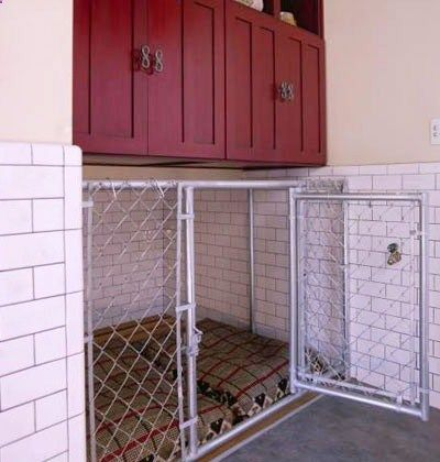 IN GARAGE…Stylish Dog Kennel: A built-in, chain-link kennel outfitted with two dog beds provides the perfect indoor shelter for your furry friends. Cabinets and cubbies store pet food and other supplies.