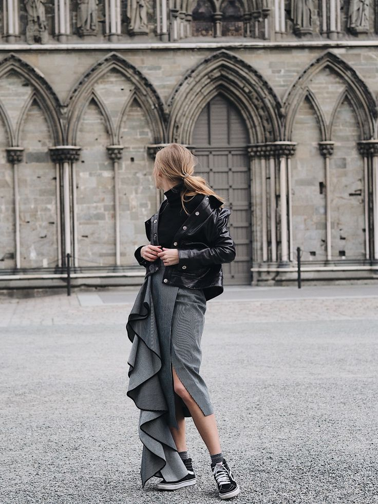 Tine Andrea Lauvli wears Paco Rabanne Motorcycle Jacket, Vetements Wool Longline Turtle Neck Sweater and Solace London Aideen Denim Skirt. Available on Style.com