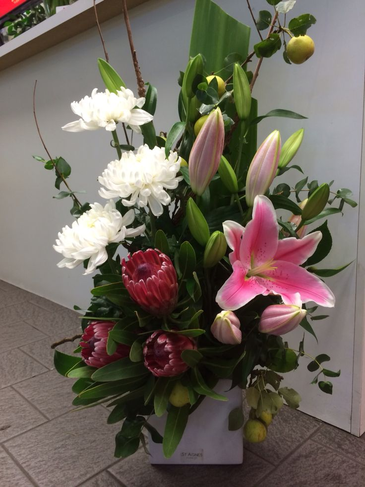White disbuds, pink ice proteas, pink orientals and ornamental pear greenery