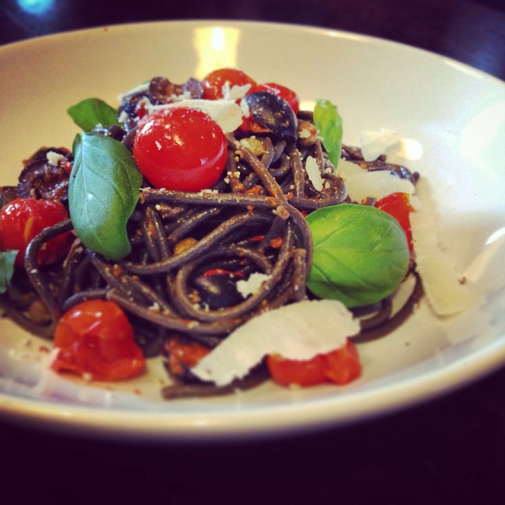 Squid ink pasta with anchovies, cherry tomatoes, chilli, capers and black olives.