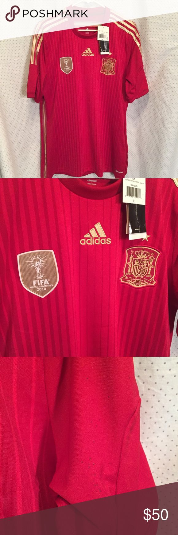 """Adidas Spain Soccer Jersey world champs 2010 NEW Adidas Spain Soccer Jersey with FIFA New with tags world champions 2010 patch. Red in red striped with gold detailed should strips.  New with tags, selling for my son, size large. There are some tiny spots in left arm, I'm sure they will come out in the wash but since this is new with tags I don't want to wash it. Measures, 42x30"""" adidas Shirts"""