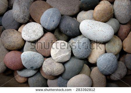 colorful multicolored pebbles on seashore                                - stock photo