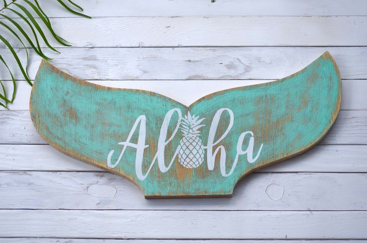 Aloha Mermaid Tail. Our Aloha Mermaid Tail Wooden Sign is perfect for your home. Hand cut into the shape of a Mermaid's tail, sanded, and hand-painted using up-cycled wood sign, then dried on our lanai by the Hawaiian Sun.   Each piece is artisan crafted, which means no two pieces are exactly alike. Each one is unique and we like it that way.   Perfect for gift giving, as well. Only $50.00