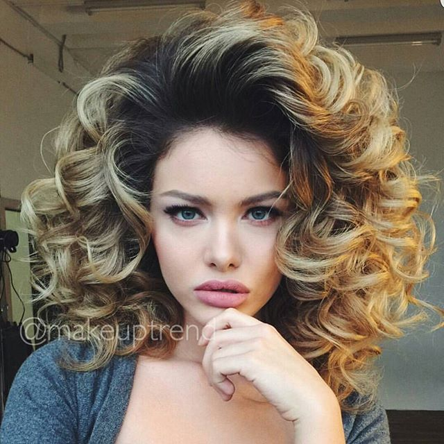 To create this modern Marilyn inspired 'do, start with a curling iron set, brush out and spray Big Sexy Hair What A Tease at roots all through hair, smooth and set with Big Sexy Hair Spray and Play to set the curls! https://www.sexyhair.com/products.html?hair_collect=52