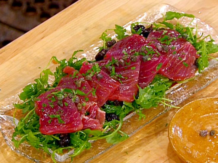 Tuna Carpaccio with Capers, Olives, Lemon Zest, Arugula and Olive Oil recipe from Emeril Live via Food Network