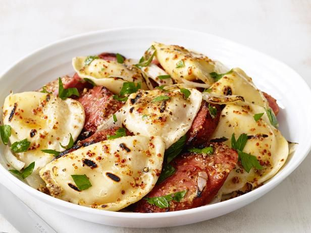 Pick up store-bought pierogies and try cooking them outside. Top off the Grilled Pierogies with grilled pork or turkey kielbasa and grilled onions.