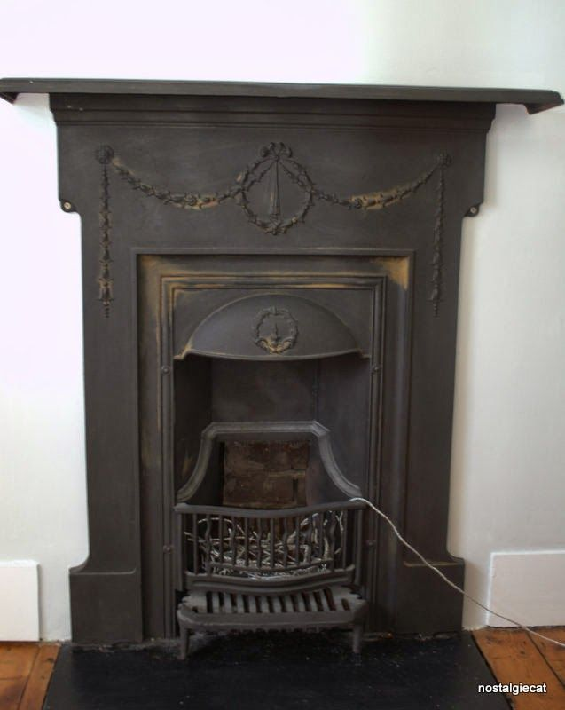 nostalgiecat: How to: Remove rust from a cast iron fireplace