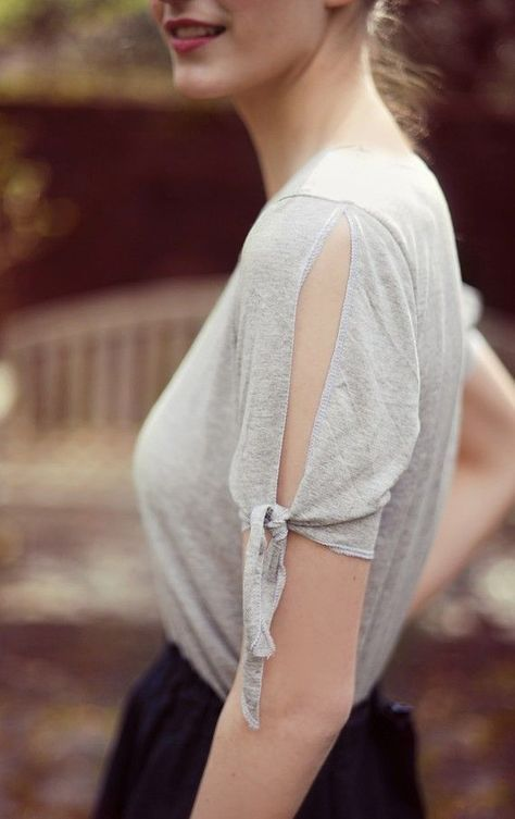 Slit and tied sleeves on a cut out T-shirt upcycle.