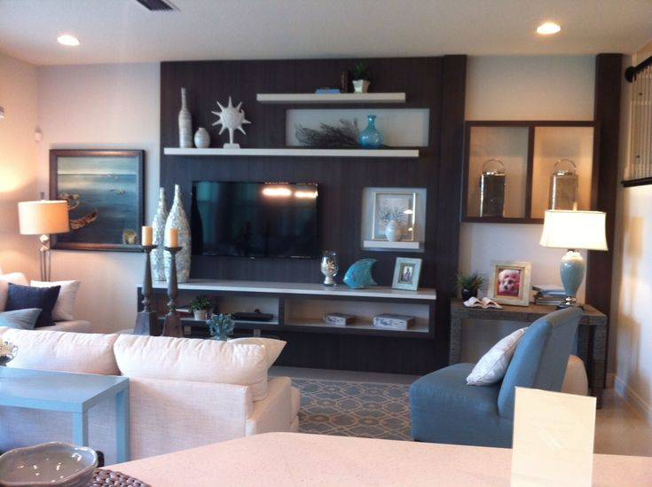 Add an accent color in a large area behind the tv, but maybe not the whole wall? Shelves on either side.
