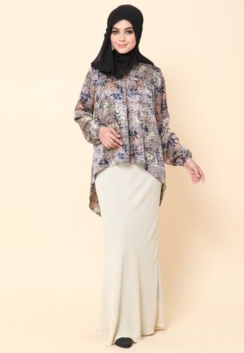 Mini Kurung Fishtail Coffee from Dirs in Brown -Matte satin printed as top kurung with a matching heavy georgette bias-cut skirt -This precious combo will definitely bring the fancy casual looks -Perfect for everyday wear as well as for occasions ... #bajukurung #bajukurungmoden